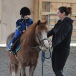 Chase Foley riding horse at farm