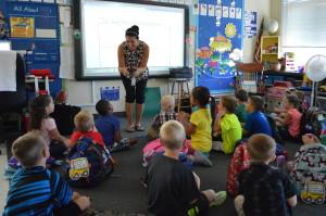 Kindergarten teacher welcomes students to class