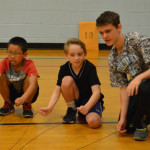 Pen pals play games in gym