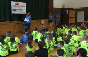 Brianne Nelson speaking to students at Green Meadow Elementary School.