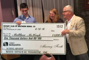 Matt McHugh '16 receives a scholarship check from Southern Rensselaer County Rotary Club president Terry Brewer and president-elect Debbie Rodriguez.