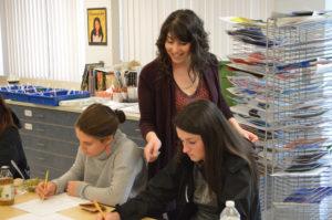 Neiman teaching art class