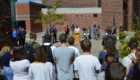 Students speak at podium during 9/11 remembrance ceremony
