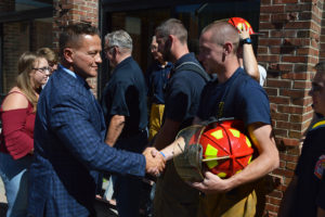 Principal Sawchuk shakes hands with firefighter