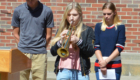 Student plays taps on trumpet