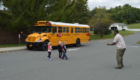 Students practice crossing in front of stopped school bus