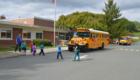 Students walk across school parking lot