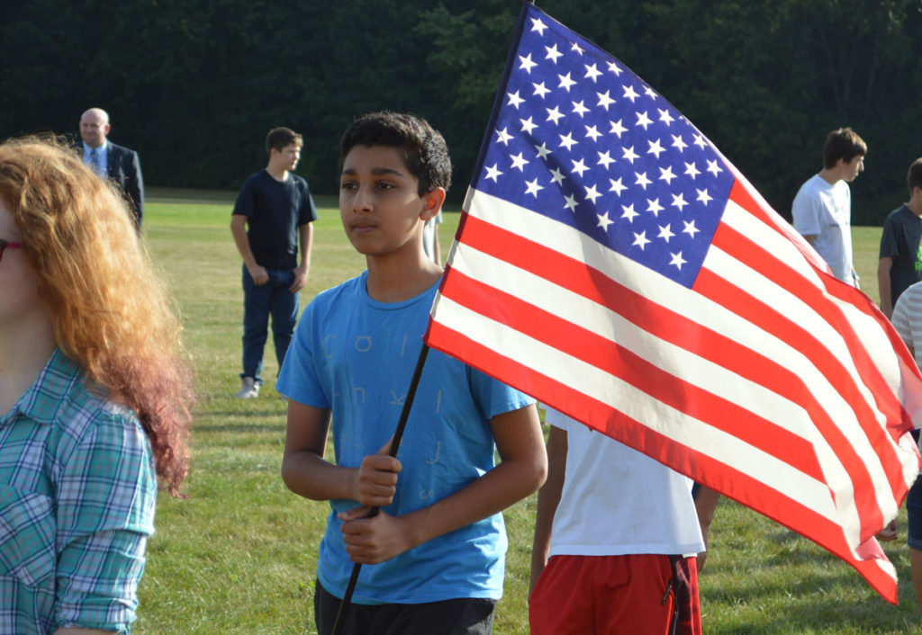 Student holds American flag