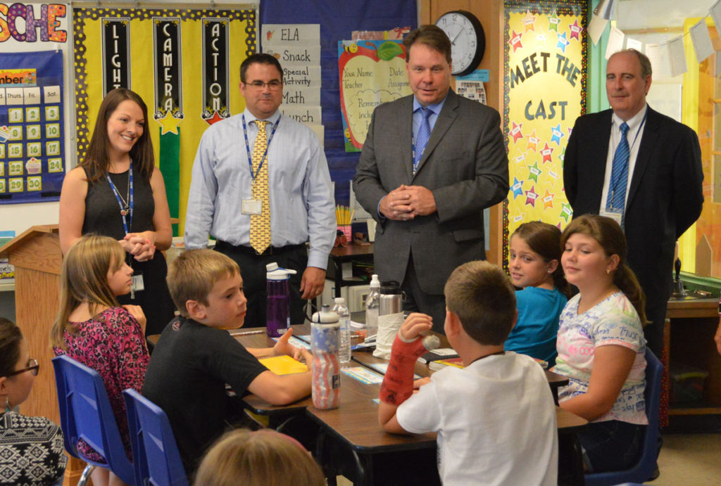Superintendent Jeff Simons speaks with students in Mrs. Kusche's class at Green Meadow Elementary School.