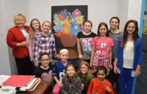 Students give artwork to Mrs. Yeomans