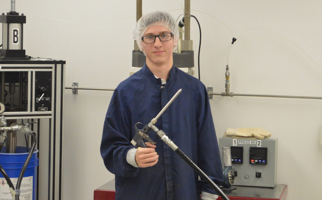 Austin Fuller '14 in a clean room at Engineered Molding Technology.