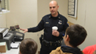 Officer Eckel gives tour of police station to students