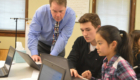 Superintendent Simons works with students