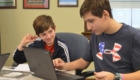 Two students work together on a chromebook