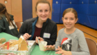 Students make a gingerbread house