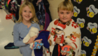 Students hold Christmas ornaments
