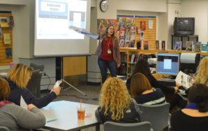 Teacher leads professional development session for staff