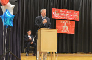 John Caporta speaking at the Red Mill Moving Up Ceremony in 2017.