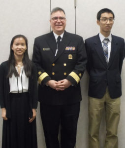 Abby Radin and Yang Yang with Rear Admiral Michael Idemarco, US Public Health Director.