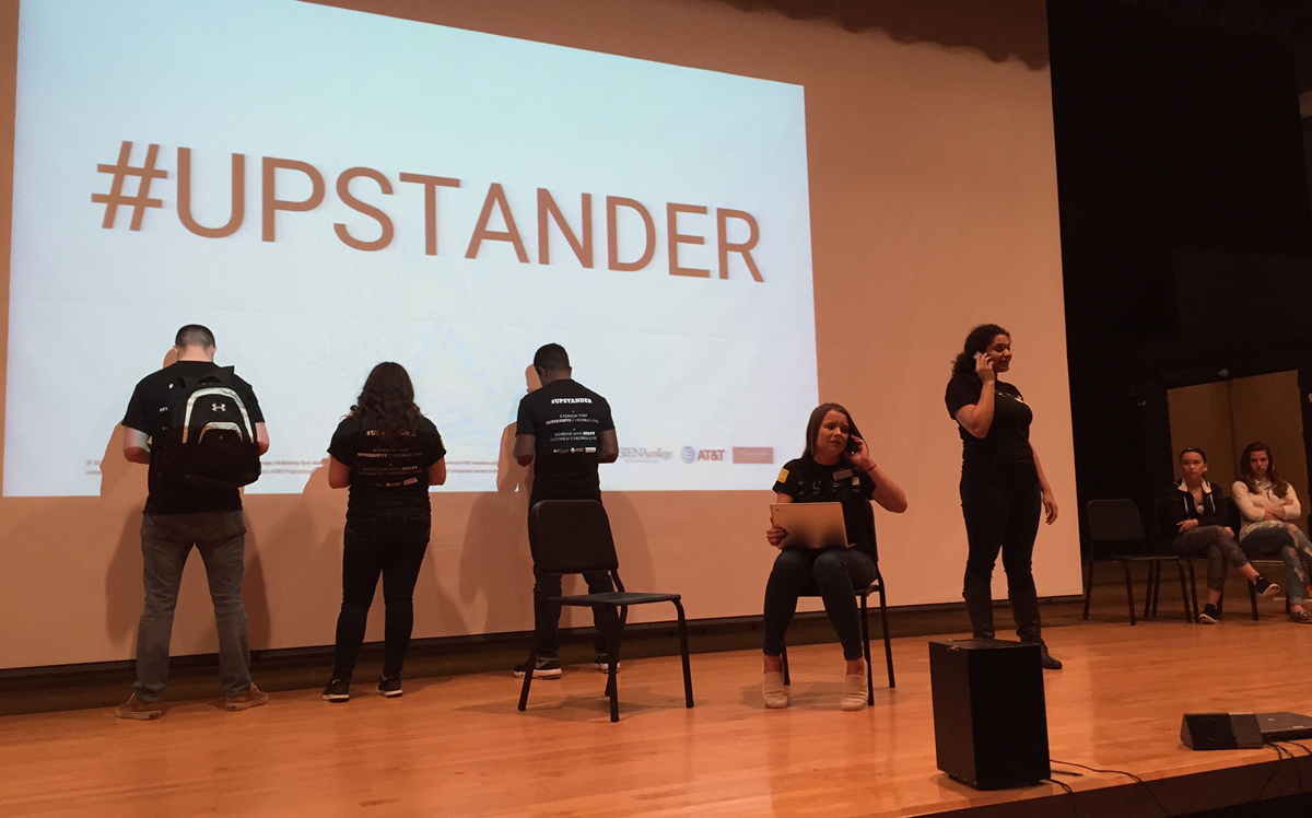 Students performing skits on stage