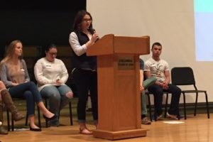 Nicole Presti speaks on stage