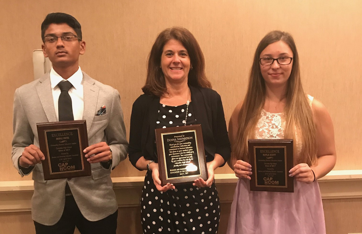Miraj Patel, Mrs. Shepardson and Kayla Scott at the Business and Marketing Educators' Association of the Capital District awards ceremony.