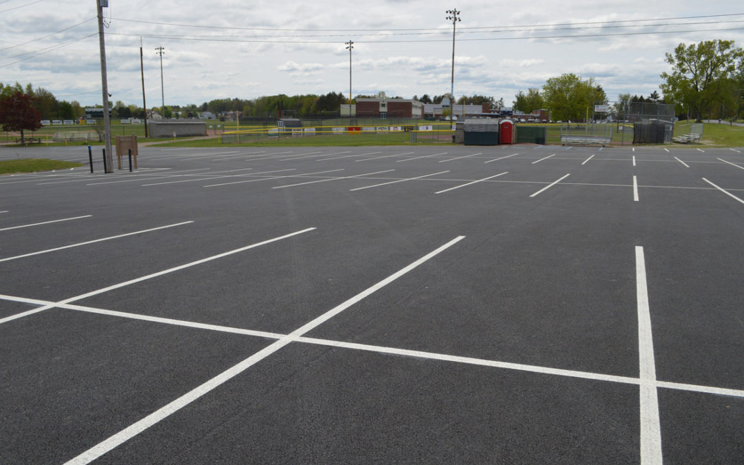 District Pitches In for New Parking Lot