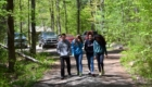 Students walk together on trail