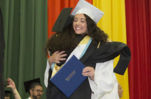 Elizabeth Vlieg hugs her mother at Columbia graduation