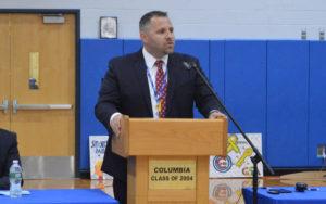 Wayne Grignon speaking from podium