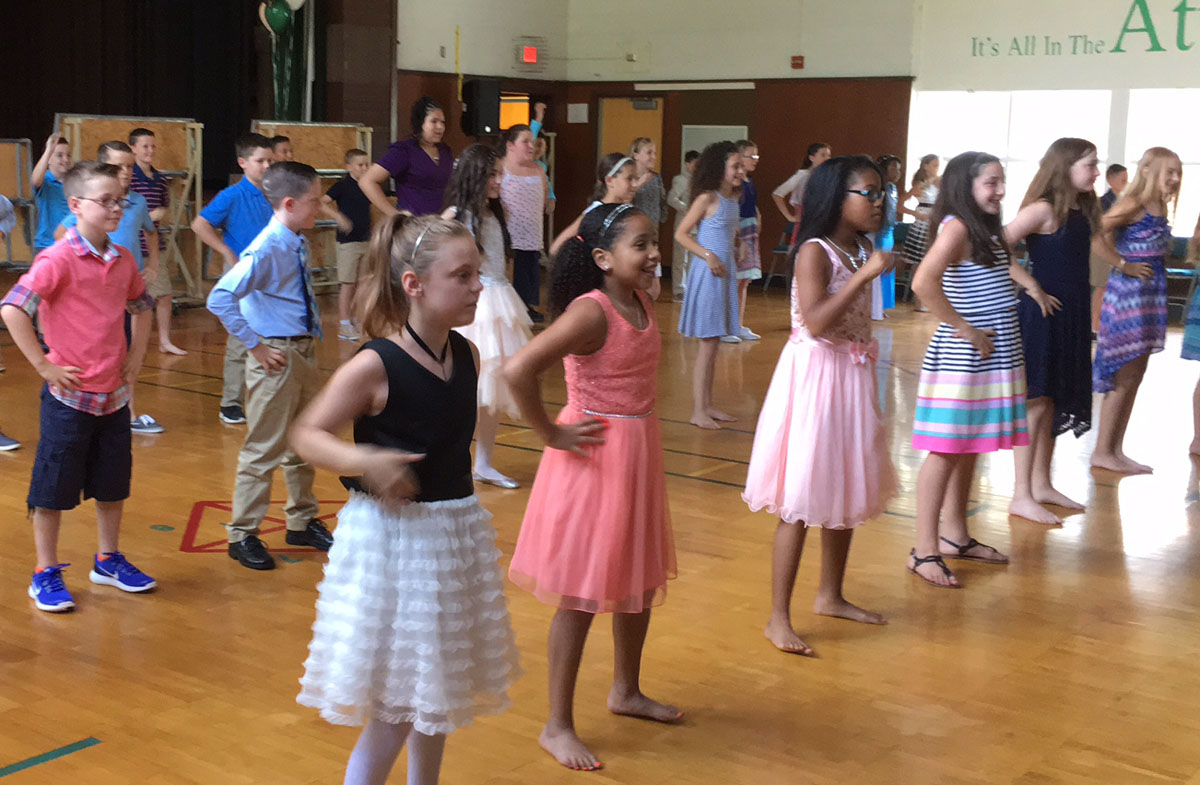 Students dance at their Moving Up Ceremony