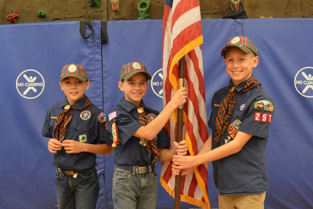 Green Meadow Boy Scouts with American flag