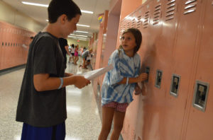 Students open lockers