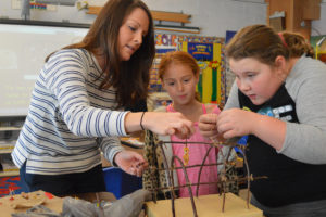 Green Meadow students making longhouses