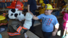 Student gives high five to Sparky the fire dog