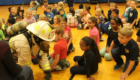 Fireman crawling on floor during fire safety presentation