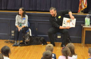Dan Harper reads to students