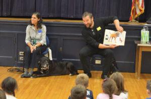 Dan Harper reads to students