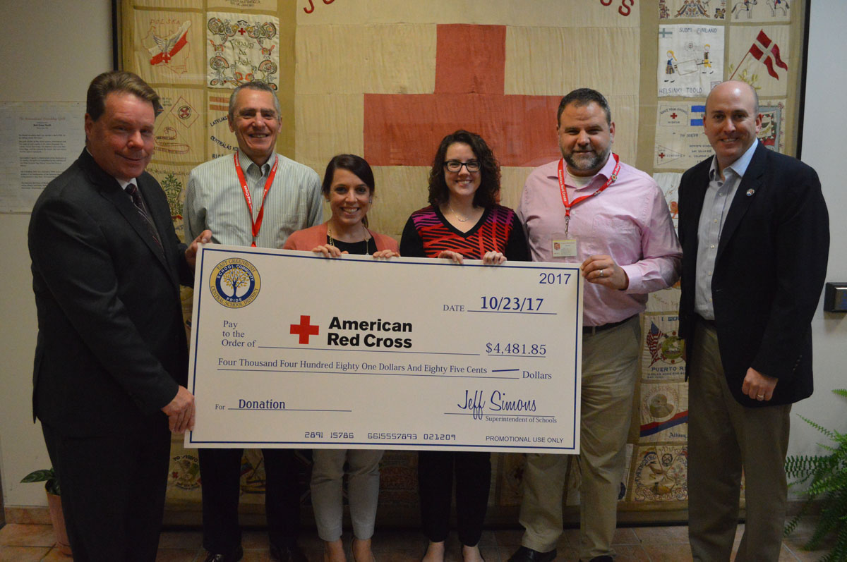 Superintendent Jeff Simons presents a donation on behalf of East Greenbush Central School District to the American Red Cross