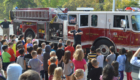 Firefighter talks to students at Genet Elementary School