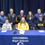 Columbia High School student athletes with family