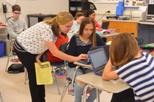 Mrs. Snyder assisting students
