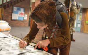 Student submits raffle ticket on Star Wars Day