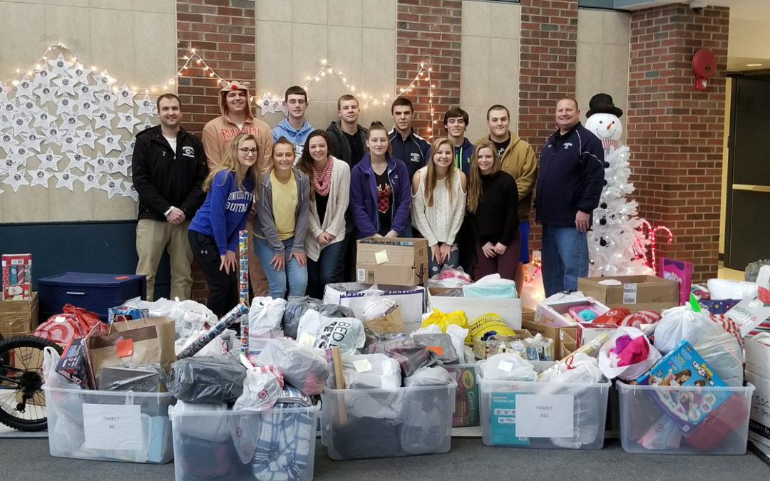 Athletics Donates Presents for Adopt-a-Families