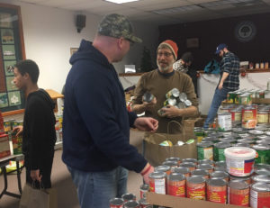 East Greenbush teachers package holiday dinner baskets at the Nassau Resource Center Food Pantry