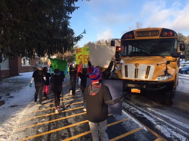 Students welcome others to school