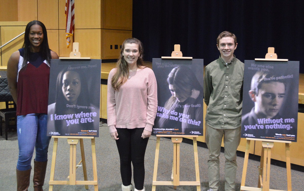 Students with the artwork from a social media ad campaign