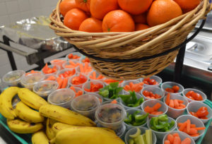 Fruits and vegetables in lunch line