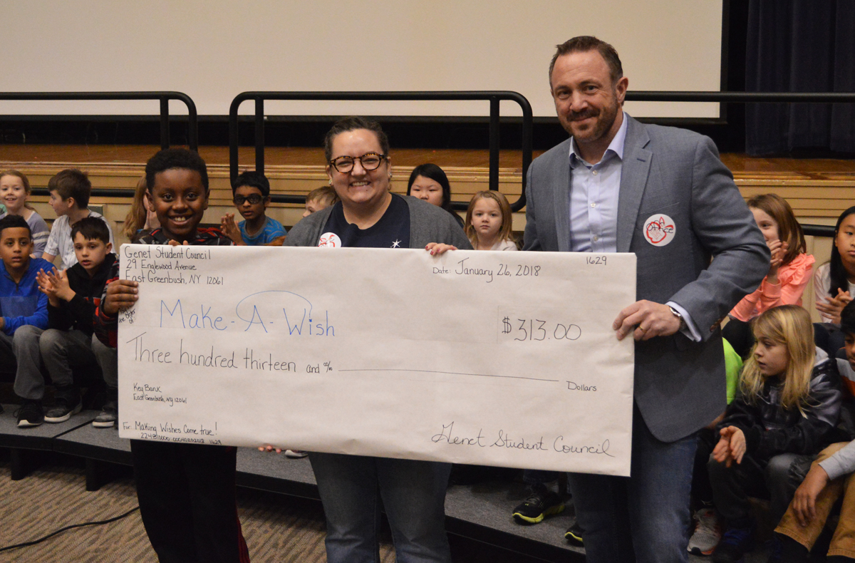 Genet presents check to Make-a-Wish