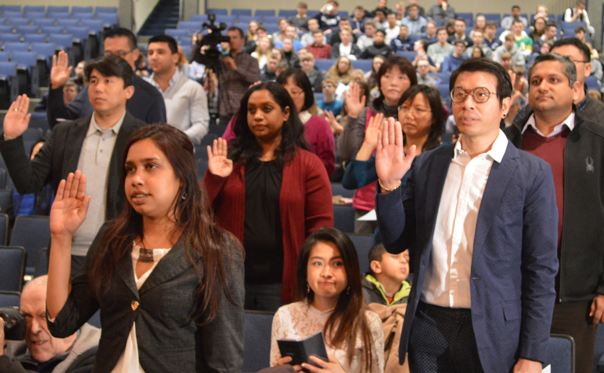 Candidates to become U.S. citizens take the Oath of Allegiance